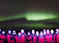 Happy faces under the Northern Lights